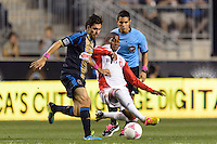 Michael Farfan (21) of the Philadelphia Union and Jeremy Hall (25) of Toronto FC. The Philadelphia Union defeated Toronto FC 1-0 during a Major League Soccer (MLS) match at PPL Park in Chester, PA, on October 5, 2013.