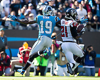 The Carolina Panthers defeated the Atlanta Falcons 34-10 in an inter-division rivalry played in Charlotte, NC at Bank of America Stadium.  Atlanta Falcons cornerback Desmond Trufant (21) steps in front of Carolina Panthers wide receiver Ted Ginn (19) to intercept a pass.