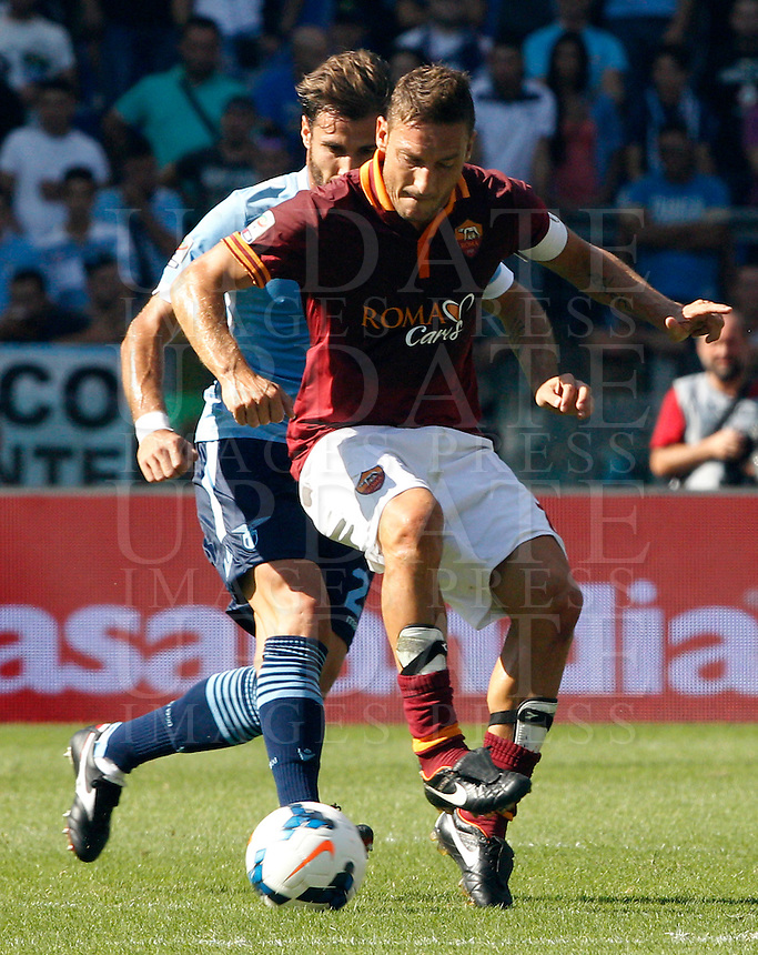 Calcio, Serie A: Roma vs Lazio. Roma, stadio Olimpico, 22 settembre 2013.<br /> AS Roma forward Francesco Totti, right, is challenged by Lazio defender Lorik Cana, of Kosovo, during the Italian Serie A football match between AS Roma and Lazio, at Rome's Olympic stadium, 22 September 2013.<br /> UPDATE IMAGES PRESS/Riccardo De Luca