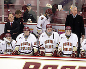 Tommy Cross (BC - 4) heads off the bench with Bert Lenz (BC - Dir-Sports Medicine). - The Boston College Eagles defeated the visiting Merrimack College Warriors 3-2 on Friday, October 29, 2010, at Conte Forum in Chestnut Hill, Massachusetts.