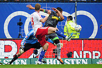 FUSSBALL   1. BUNDESLIGA   SAISON 2011/2012    6. SPIELTAG Hamburger SV - Borussia Moenchengladbach            17.09.2011 Igor DE CAMARGO (re, Moenchengladbach) erzielt das Tor zum 0:1. Die Hamburger Slobodan RAJKOVIC (li) und Torwart Jaroslav DROBNY (hinten, beide Hamburg) kommen zu spaet