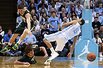 30 December 2014: North Carolina's Marcus Paige (5) and William and Mary's Michael Schlotman (11) and Sean Sheldon (below) stumble after a loose ball. The University of North Carolina Tar Heels played the College of William & Mary Tribe in an NCAA Division I Men's basketball game at the Dean E. Smith Center in Chapel Hill, North Carolina. UNC won the game 86-64.