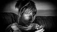 Young Woman using Mobile Cell Phone - Jul 2014.