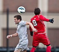 Tommy Muller (8) of Georgetown goes up for a header with Andres Vargas (9) of St. John's during the game at North Kehoe Field in Washington DC. Georgetown defeated St. John's, 2-1, in the Big East conference tournament quarterfinals.