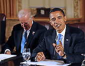 Chicago, IL - November 7, 2008 -- United States President-elect Barack Obama (R) and Vice president elect Joseph Biden (L) meet with members of the Transition Economic Advisory Board at the Hilton Hotel in downtown Chicago, Illinois, USA 07 November 2008. Obama later held his first news conference since winning the election..Credit: Tannen Maury - Pool via CNP