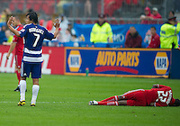 24 July 2010: FC Dallas forward Milton Rodriguez #7 pleads to the referee after tackling Toronto FC midfielder Amadou Sanyang #22 during a game between FC Dallas and Toronto FC at BMO Field in Toronto..The final score was a 1-1 draw...