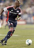 New England Revolution forward Dimitry Imbongo (92) looks to pass. In a Major League Soccer (MLS) match, the New England Revolution (blue) defeated D.C. United (white), 2-1, at Gillette Stadium on September 21, 2013.