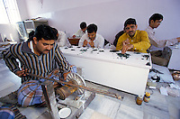 In Jaipur India, the world capital leader of Emerald cutter, those men's are in charge of selecting by size and quality of colour the stone