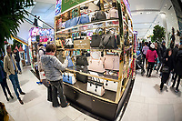 Shoppers browse Kate Spade handbags in the Macy's Herald Square flagship store on Sunday, March 26, 2017. (© Richard B. Levine)