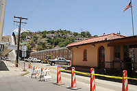 Nogales, Arizona - A small building (right) serves as a border crossing station in the city of Nogales, Arizona which borders  with the city of Nogales, Sonora, Mexico. Nogales is the largest international border town of the state of Arizona. Nogales sees a large and constant flow of international vehicular and pedestrian traffic. Photo by Eduardo © 2012