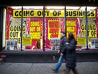 National Wholesale Liquidators in New York advertises it's going out of business sale on Sunday, January 18, 2009. (© Richard B. Levine)