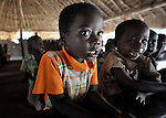 Children study in a Catholic Church-sponsored school in the Makpandu refugee camp in Southern Sudan, 44 km north of Yambio, where more that 4,000 people took refuge in late 2008 when the Lord's Resistance Army attacked their communities inside the Democratic Republic of the Congo. Attacks by the LRA inside Southern Sudan and in the neighboring DRC and Central African Republic have displaced tens of thousands of people, and many worry the attacks will increase as the government in Khartoum uses the LRA to destabilize Southern Sudan, where people are scheduled to vote on independence in January 2011. Catholic pastoral workers have accompanied the people of this camp from the beginning. NOTE: In July 2011 Southern Sudan became the independent country of South Sudan.