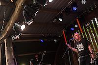 Attila the Stockbroker onstage.