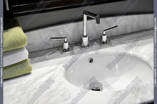 Bathroom sink with gray marble counter