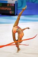 Aliya Yussupova competing for Kazakhstan...back flexion with ribbon during qualifications round at Athens Olympic Games on August 27, 2004 at Athens, Greece. (Photo by Tom Theobald)