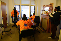"Cease Fire outreach workers and violence interrupters (l-r) James Sima, 39, Donya Smith, 26, Jerusha ""Rue"" Hodge, 42, and supervisor Ulysses ""US"" Floyd finishing up a briefing in their office on recent developments in the neighborhoods where they work with at risk youth participants on the far South Side of Chicago, Illinois on February 3, 2017.  Cease Fire is a public health initiative that attempts to stop or halt gun violence across the city."