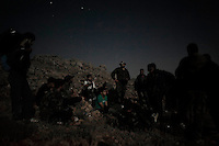 Free Syrian Army members take a rest as they areclimbing mountains to reach strategic positions at night to avoid Al Assad army patrols. ALESSIO ROMENZI