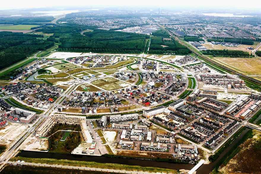 Nederland, Amsterdam, 10 aug 2013<br /> Zicht op Almere, luchtfoto. In deze wijk worden veel eigen ontworpen huizen gebouwd.<br />   <br /> Foto(c): Michiel Wijnbergh