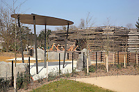 Giraffes' rest area and shelter, with the giraffes in a temporary enclosure in front of their building, behind, in the Zone Sahel-Soudan at the new Parc Zoologique de Paris or Zoo de Vincennes, (Zoological Gardens of Paris or Vincennes Zoo), which reopened April 2014, part of the Musee National d'Histoire Naturelle (National Museum of Natural History), 12th arrondissement, Paris, France. Picture by Manuel Cohen