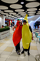 Edinburgh, UK. 15.04.2017. Two women, dressed as a chilli pepper and a banana, pose for a photo in Princes Street Mall. Photograph © Jane Hobson.
