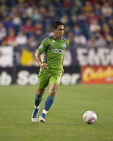 Seattle Sounders forward David Estrada (16) brings the ball forward. In a Major League Soccer (MLS) match, the Seattle Sounders FC defeated the New England Revolution, 2-1, at Gillette Stadium on October 1, 2011.