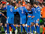 Dundee Utd v St Johnstone...25.09.10  .Ref Brian Winter separates Prince Buaben and Jody Morris.Picture by Graeme Hart..Copyright Perthshire Picture Agency.Tel: 01738 623350  Mobile: 07990 594431