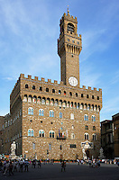 Low angle view of Palazzo Vecchio, Piazza della Signoria, Florence, Tuscany, Italy, pictured on March 22, 2011, in the afternoon. The Palazzo Vecchio, begun in 1299, was designed by Arnolfo di Cambio (1245-1302), and was originally known as the Palazzo di Signoria, after the Signoria or ruling body of Florence. It is built in rusticated stonework topped with crenellations, with two rows of Gothic trefoil arched windows. It now houses both a museum and the office of the mayor of Florence. Florence, capital of Tuscany, is world famous for its Renaissance art and architecture. Its historical centre was declared a UNESCO World Heritage Site in 1982. Picture by Manuel Cohen