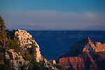 Last rays of sunlight on the cliffs along the north rim of Grand Canyon