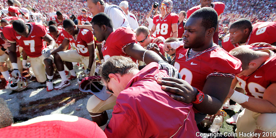 TALLAHASSEE, FL 10-FSU-BC 101610 FB10 CH-Florida State Head Coach Jimbo Fisher, center joins players at midfield for a prayer after the Boston College game Saturday at Doak Campbell Stadium in Tallahassee. The Seminoles beat the Eagles 24-19. .COLIN HACKLEY PHOTO