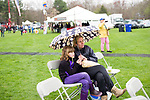 Woodbury, CT- 22 April 2017-042217CM06-  Kristel Ratas and her daughter Freyja Smith, 7 both of Brewster,  NY listen to the sounds of The Dr. Steve Band during the 22nd Annual Woodbury Earth Day celebration at Hollow Park in Woodbury on Saturday. Also with her is her other daughter Akiranova 9 months old.  The event sponsored by Pomperaug River Watershed Coalition, featured vendors, resources and demonstrations from conservation-minded stores, artists and food vendors.  Christopher Massa Republican-American