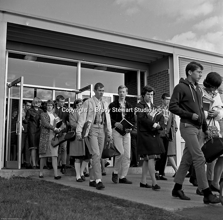Bethel Park Senior High School:  View of students coming out of Building #1 between classes. The new Bethel Senior High School was dedicated on October 23, 1960, but the campus would not grow to its current size until seven years later. Phase II of the construction was completed in 1964 with the addition of another academic building and the industrial arts building. Phase III was completed in 1967 with the construction of the fourth academic building and a 6,300 seat football stadium and track, three tennis courts, seven basketball courts and a baseball field.