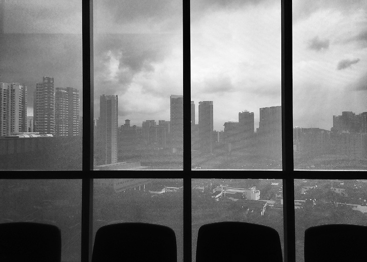 Hi,<br /> <br /> This was taken from a conference room at Duke-NUS Graduate Medical School in Singapore. It was a grey day (afternoon rainstorms are common especially late in the year) but the view and skyline from that room was still pretty breathtaking-and such a contrast to the relatively flat views we get in Durham. The building itself is gorgeous and dramatic, very similar to the French Family Science Center here.