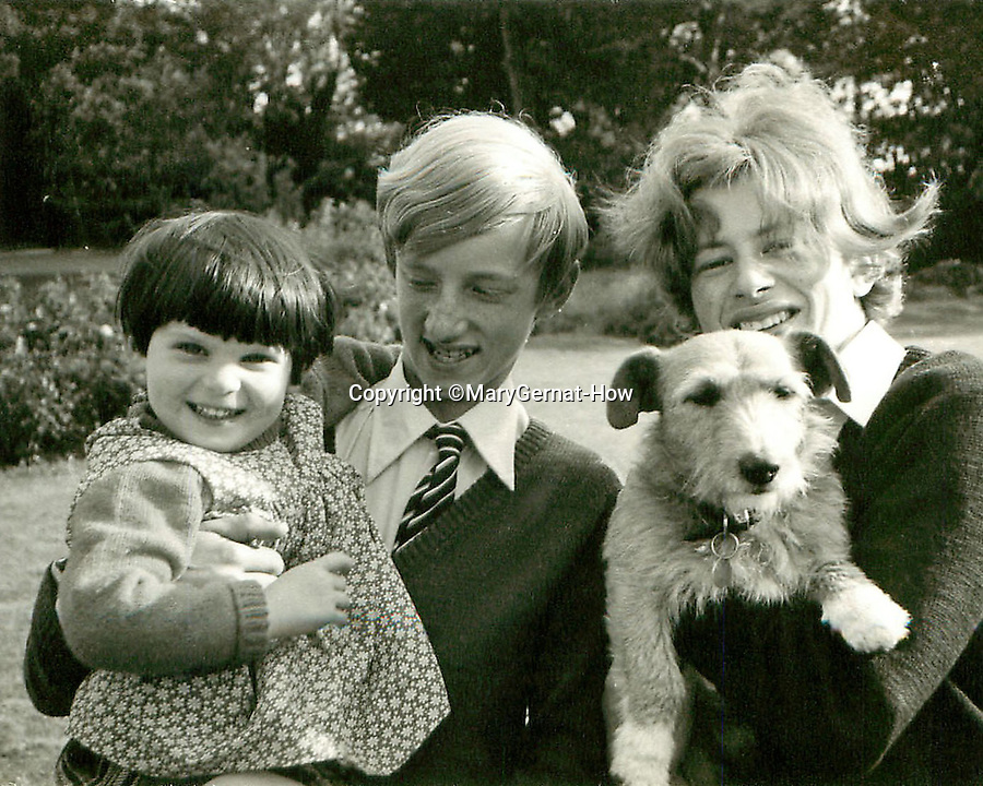 BNPS.co.uk (01202 558833)<br /> Pic: MaryGernat-How/BNPS<br /> <br /> ***Single Use - Not For Archive***<br /> <br /> Daughter Bridget with her brothers Nick and Justin...and they even had a pet dog called Patch.<br /> <br /> The real family behind Enid Blyton's iconic book covers has been revealed for the first time thanks to a hidden archive of sketches and family photos.<br /> <br /> Mary Gernat, who created the paperback covers for about 100 children's books in the 1960s, would get her young sons to stop mid-play and pose for her while she quickly sketched ideas for books like The Famous Five, the Secret Series, St Clare's and Malory Towers.<br /> <br /> Her son Roger How, 58, has now unveiled some of his mother's never-seen-before original sketches and finished book drafts which capture the classic images of childhood adventure he and his brothers helped create.