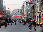 Workers on their bikes in the busy Canton streets. Pictures taken in Canton China in 1977 at the time of the cultural revolution.