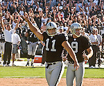 Oakland Raiders kicker Sebastian Janikowski (11) and punter Shane Lechler (9) celebrate game winning field goal on Sunday, September 14, 2003, in Oakland, California. The Raiders defeated the Bengals 23-20.