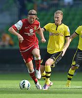 FUSSBALL   DFB POKAL   SAISON 2012/2013   1. Hauptrunde FC Oberneuland - Borussia Dortmund            18.08.2012 Soeren Seidel (li, FCO) gegen Marco Reus (re, Dortmund)