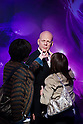 Oct. 4, 2011 - Tokyo, Japan - Japanese visitors touch the wax figure of Bruce Willis at the Madame Tussauds museum exhibit. The world's 13th Madame Tussauds museum showcases 19 wax figures of  celebrity musicians and movie stars. (Photo by Christopher Jue/AFLO)