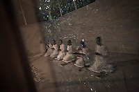 Thai nuns carry out evening meditation at the Sathira Dhammasathan meditation centre. The mae chii are the most numerous group of Thai Buddhist renunciant women.They observe eight precepts: to abstain from killing living beings; to abstain from taking what has not been given; to abstain from sexual activity; to abstain from lying speech; to abstain from drinking liquor or taking anything that may intoxicate the mind; to abstain from eating after noon; to abstain from watching dancing, singing, shows and from adorning oneself; to abstain from using a high bed.