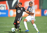 Dwayne De Rosario (7) of D.C. United goes against Leonardo (22) of the Los Angeles Galaxy.  D.C. United tied the Los Angeles Galaxy 2-2, at RFK Stadium, Saturday September 14 , 2013.