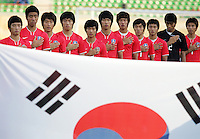 South Korea salutes while its National Anthem is played before the FIFA Under 20 World Cup Quarter-final match between Ghana and South Korea at the Mubarak Stadium  in Suez, Egypt, on October 09, 2009.