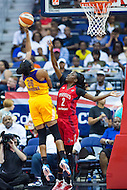 Washington, DC - July 22, 2016: Los Angeles Sparks forward Nneka Ogwumike (30) hits a hook shot over Washington Mystics forward Kahleah Copper (2) during their match up at the Verizon Center in Washington, DC. (Photo by Phil Peters/Media Images International)