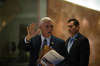 United States Vice President-elect Mike Pence waves to members of the media at Trump Tower in Manhattan, New York, U.S., on Friday, November 18, 2016.<br /> Credit: John Taggart / Pool via CNP /MediaPunch