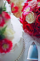 The color in a bride's flower bouquet is complemented by the color in her wedding cake. (Photo by Scott Eklund/Red Box Pictures)