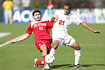 15 November 2009: NC State's Alan Sanchez (10) and Virginia's Shawn Berry (21). The University of Virginia Cavaliers defeated the North Carolina State University Wolfpack 1-0 at WakeMed Stadium in Cary, North Carolina in the Atlantic Coast Conference Men's Soccer Tournament Championship game.