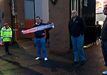 A fan with a scarf bearing the names of Liverpool and Northampton Town football clubs outside the Shankly Gates at Anfield, before the team's Carling Cup third round tie away to Liverpool. The visitors from English League 2 defeated Premier League Liverpool on penalty kicks after a 2-2 draw after extra time in one of the biggest shock results in either clubs histories.
