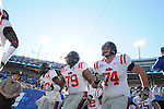Ole Miss' Bobby Massie (79) and Ole Miss' Jared Duke (74) run onto the field vs. Kentucky at Commonwealth Stadium in Lexington, Ky. on Saturday, November 5, 2011. Kentucky won 30-13...
