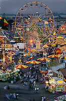 The Los Angeles County Fair is the largest county fair in America. The fair covers 487 acres of land and 200 acres are devoted to parking. The complex boasts more than 350,000 square feet of indoor exhibits, a racetrack with a 10,000-seat grandstand and 12 acres of carnival grounds.