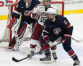Seb Lloyd (Harvard - 15), Phil Kemp (NTDP - 22) - The Harvard University Crimson defeated the US National Team Development Program's Under-18 team 5-2 on Saturday, October 8, 2016, at the Bright-Landry Hockey Center in Boston, Massachusetts.