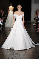 "Model walks runway in a ""Darling"" bridal gown from the Alyne by Rita Vinieris Fall 2017 collection on October 7th, 2016 during New York Bridal Fashion Week."