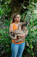 Vanessa Lizano with a two rescued Sloths at her Costa Rica Wildlife Sanctuary run by Vanessa Lizano and her family. Moin, Limon, Costa Rica.